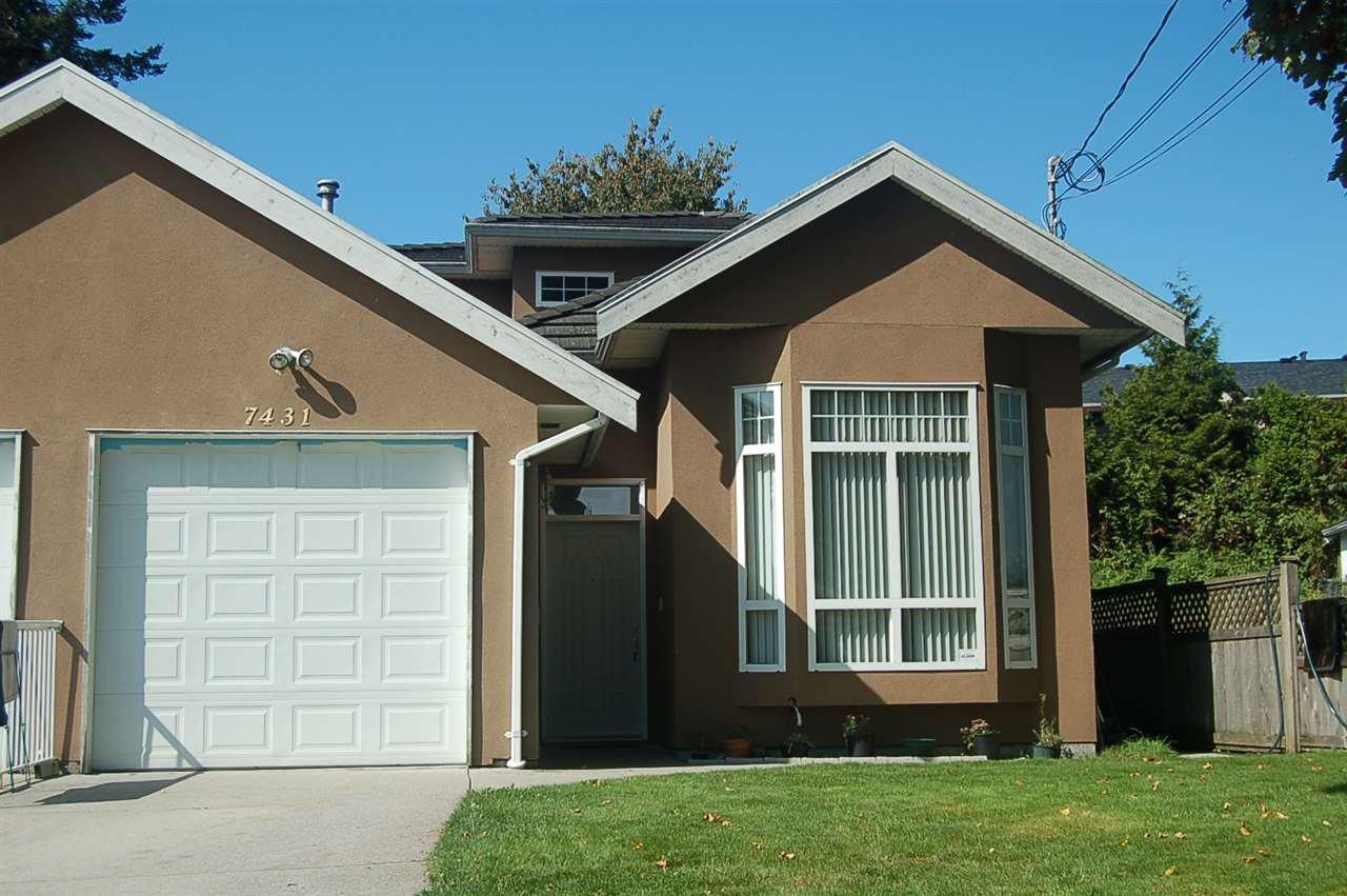 "Main Photo: 7431 14TH Avenue in Burnaby: Edmonds BE House 1/2 Duplex for sale in ""STRATA HALF DUPLEX"" (Burnaby East)  : MLS®# R2409146"