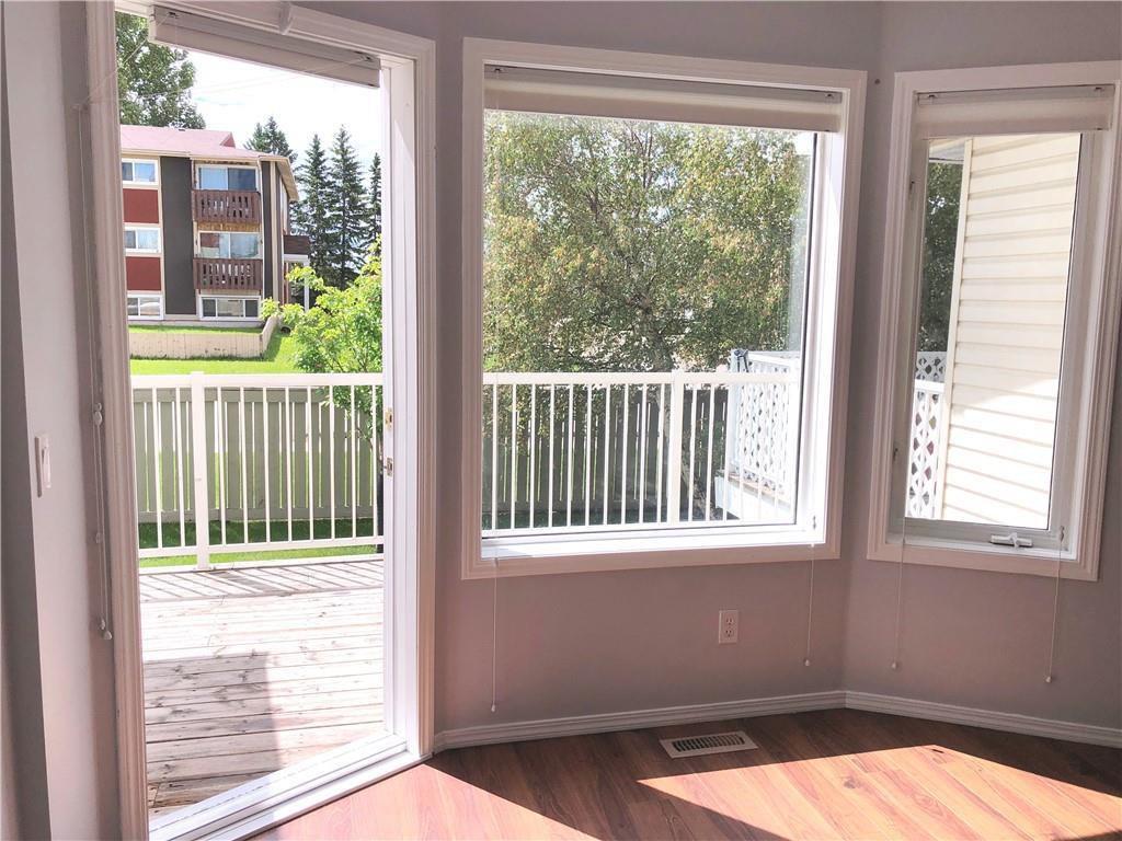 Photo 4: Photos: 29 505 Edmonton Trail NE: Airdrie Row/Townhouse for sale : MLS®# A1029452