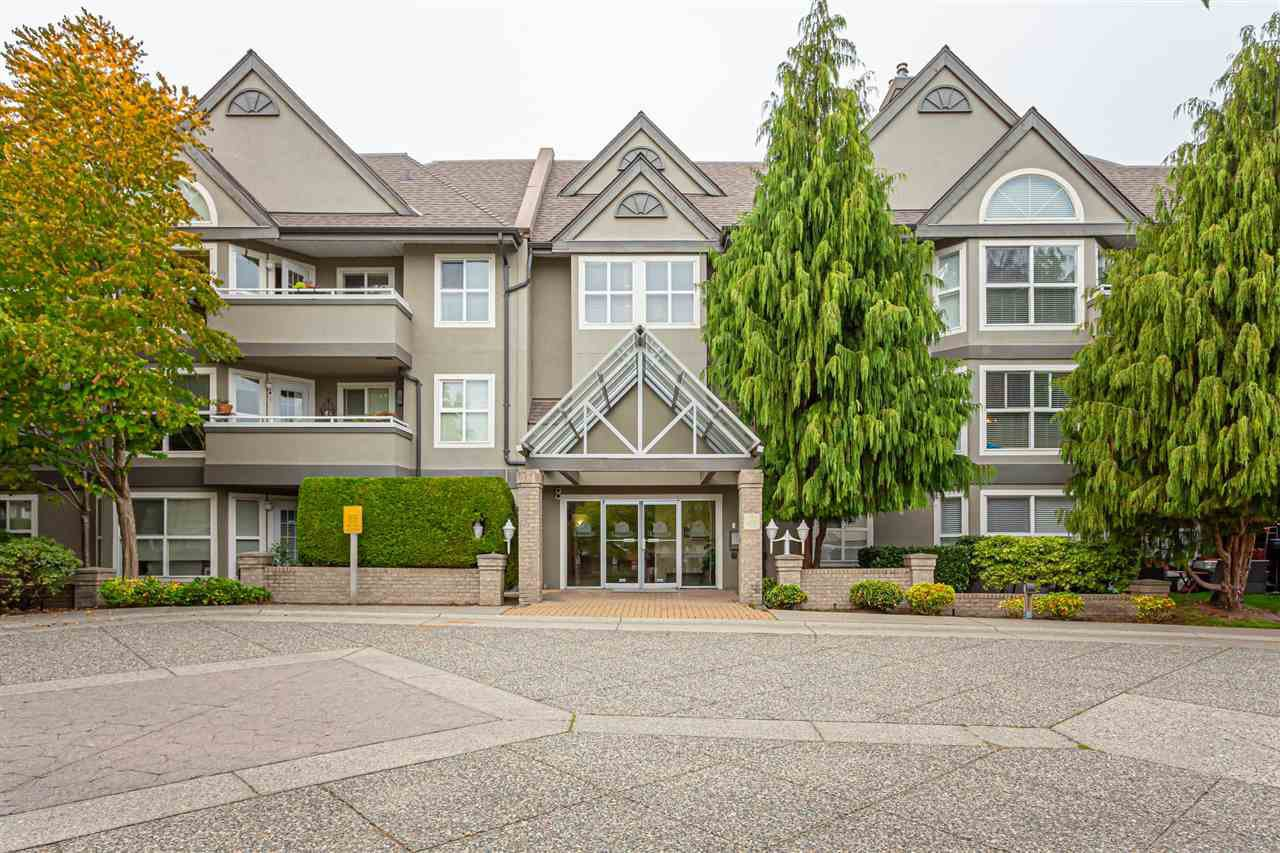 "Main Photo: 110 6557 121 Street in Surrey: West Newton Condo for sale in ""Lakewood Terrace"" : MLS®# R2504332"