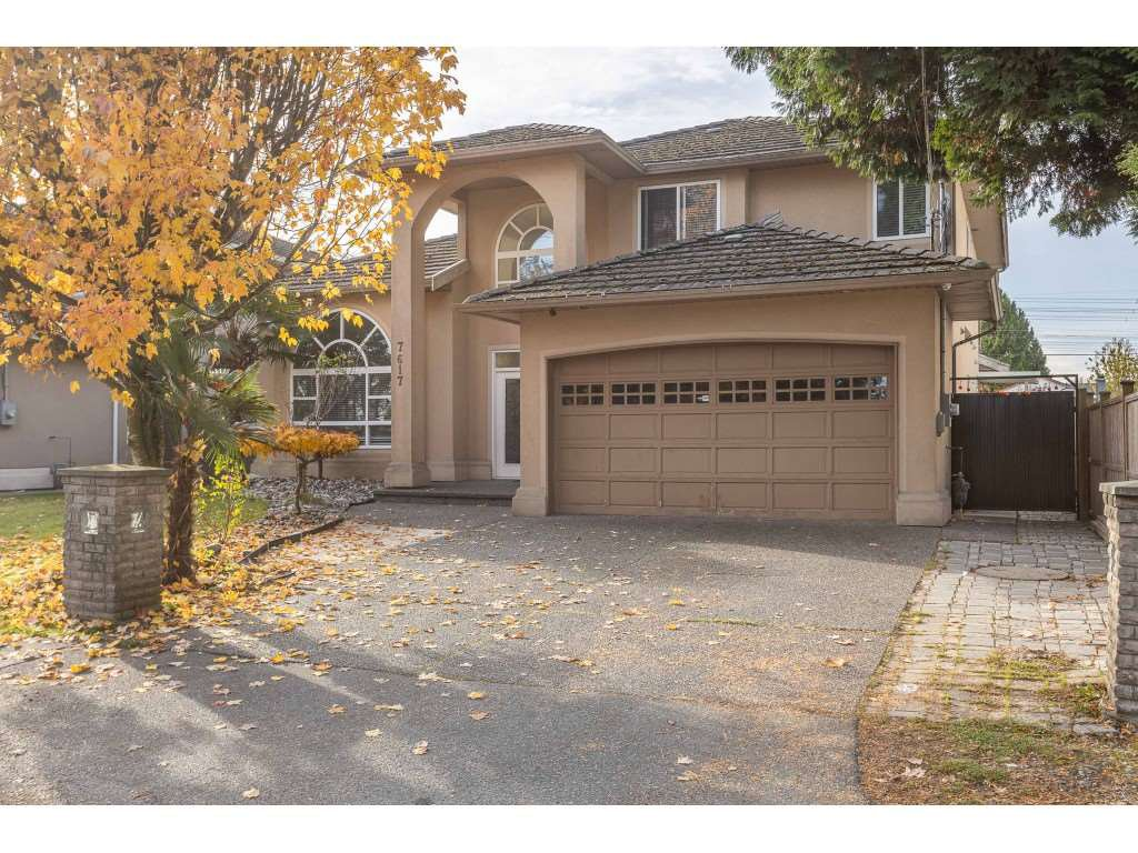 Main Photo: 7617 127 Street in Surrey: West Newton House for sale : MLS®# R2514489