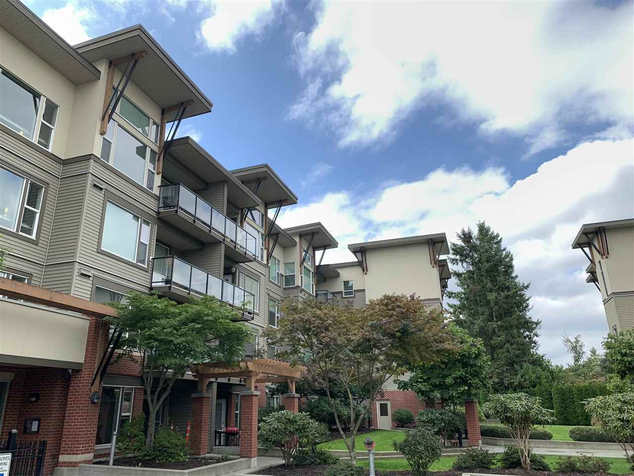 "Main Photo: 318 33539 HOLLAND Avenue in Abbotsford: Central Abbotsford Condo for sale in ""THE CROSSING"" : MLS®# R2405813"