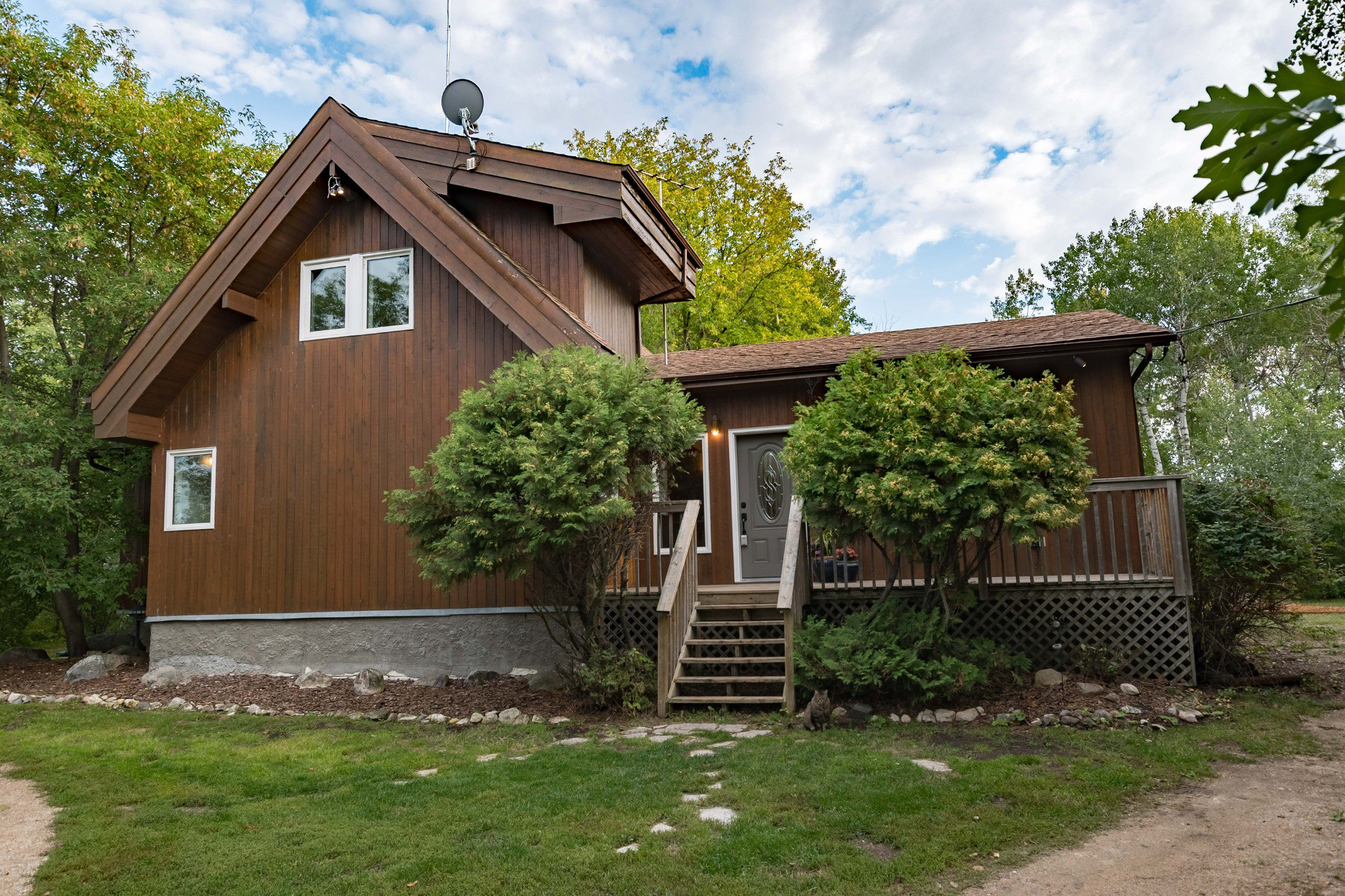HORSE LOVER'S DREAM! Fabulous Location ½ mile East of Birds Hill Park. 1616 sf 'A-Frame' Style 3 Bedroom Lindal Cedar Home on Mature Treed 6.84 acre lot. Circle driveway to front of house & separate driveway to barn & paddocks.