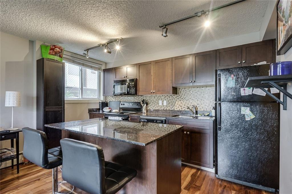 Main Photo: 106 4127 Bow Trail SW in Calgary: Rosscarrock Apartment for sale : MLS®# C4300518