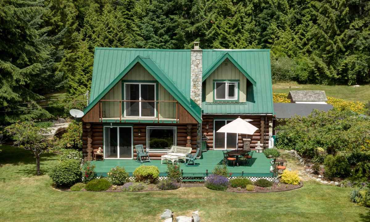 A private log home with an oceanview sits on 1.77 acres in Roberts Creek.  Ideal for small hobby farm or agricultural based business