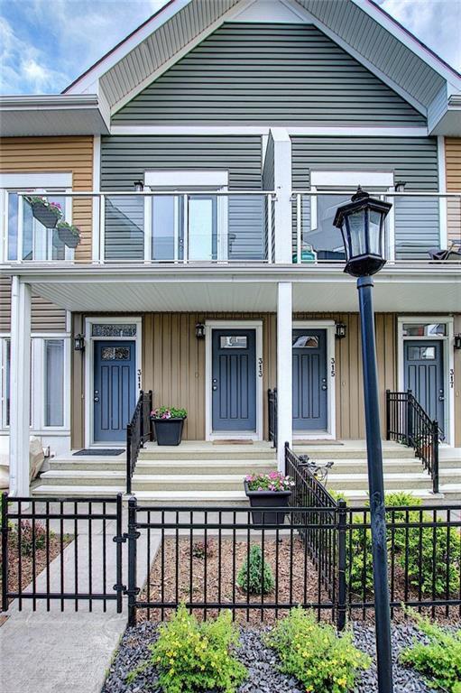Main Photo: 313 AUBURN BAY Square SE in Calgary: Auburn Bay Row/Townhouse for sale : MLS®# C4302662