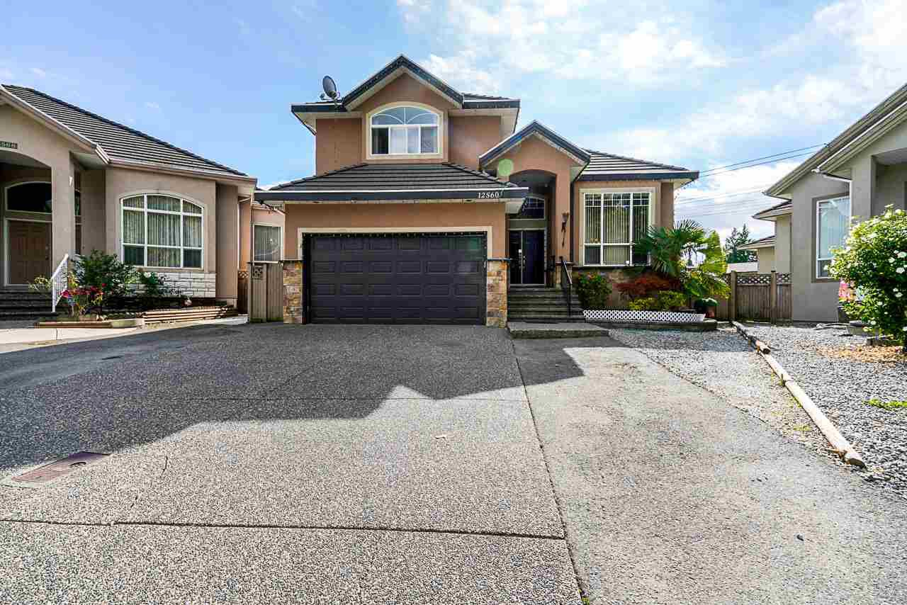 Main Photo: 12560 68A Avenue in Surrey: West Newton House for sale : MLS®# R2492861