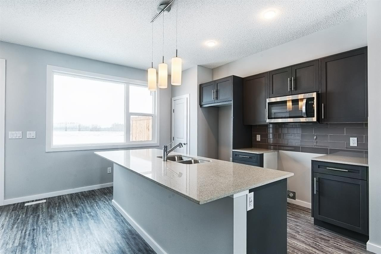 Main Photo: 1210 Rosenthal Boulevard in Edmonton: Zone 58 Attached Home for sale : MLS®# E4187828