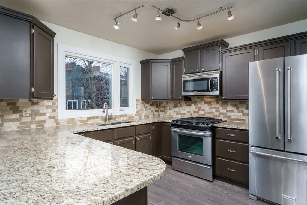 Photo 11: Photos: 523 Deermont Court SE in Calgary: Deer Ridge Detached for sale : MLS®# A1050055