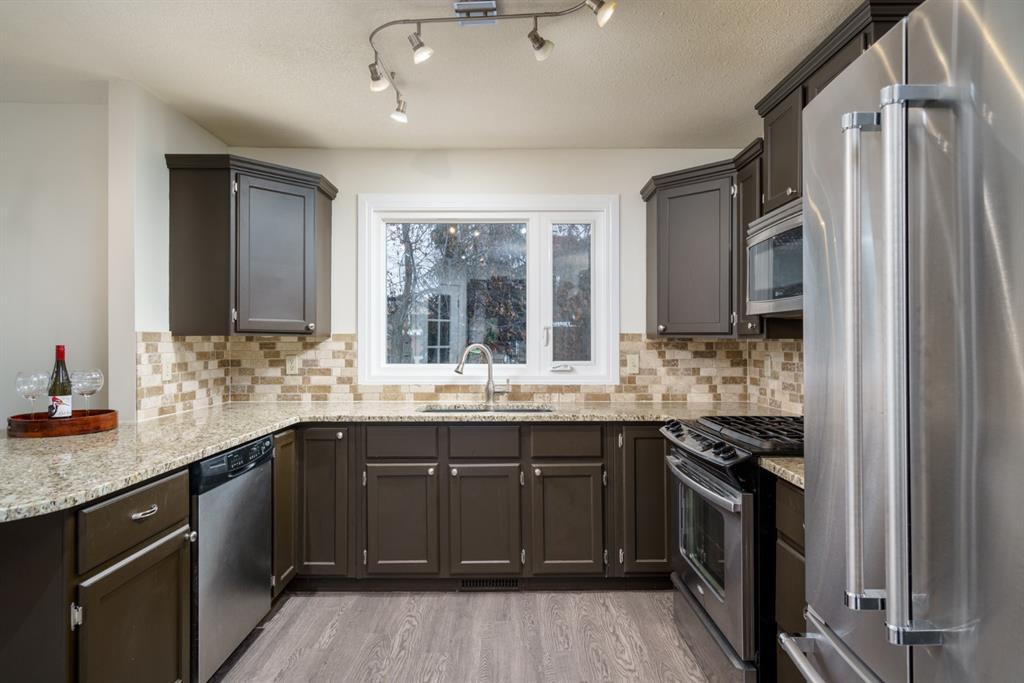 Photo 12: Photos: 523 Deermont Court SE in Calgary: Deer Ridge Detached for sale : MLS®# A1050055