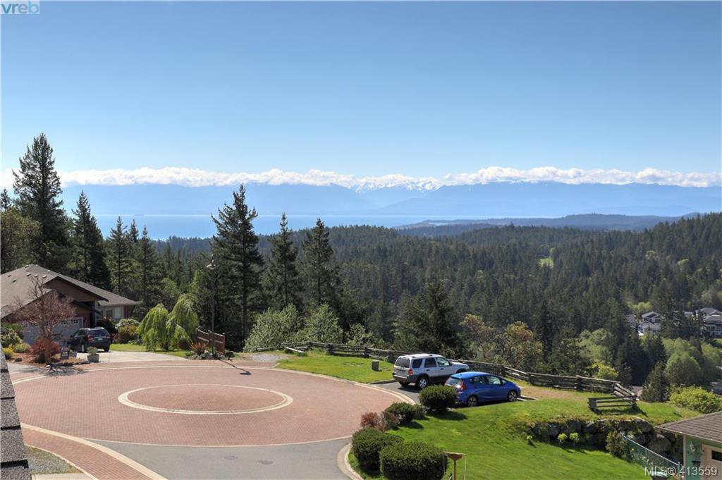 Panoramic views of Olympic Mountains, Juan de Fuca Strait and west to the Sooke hills.