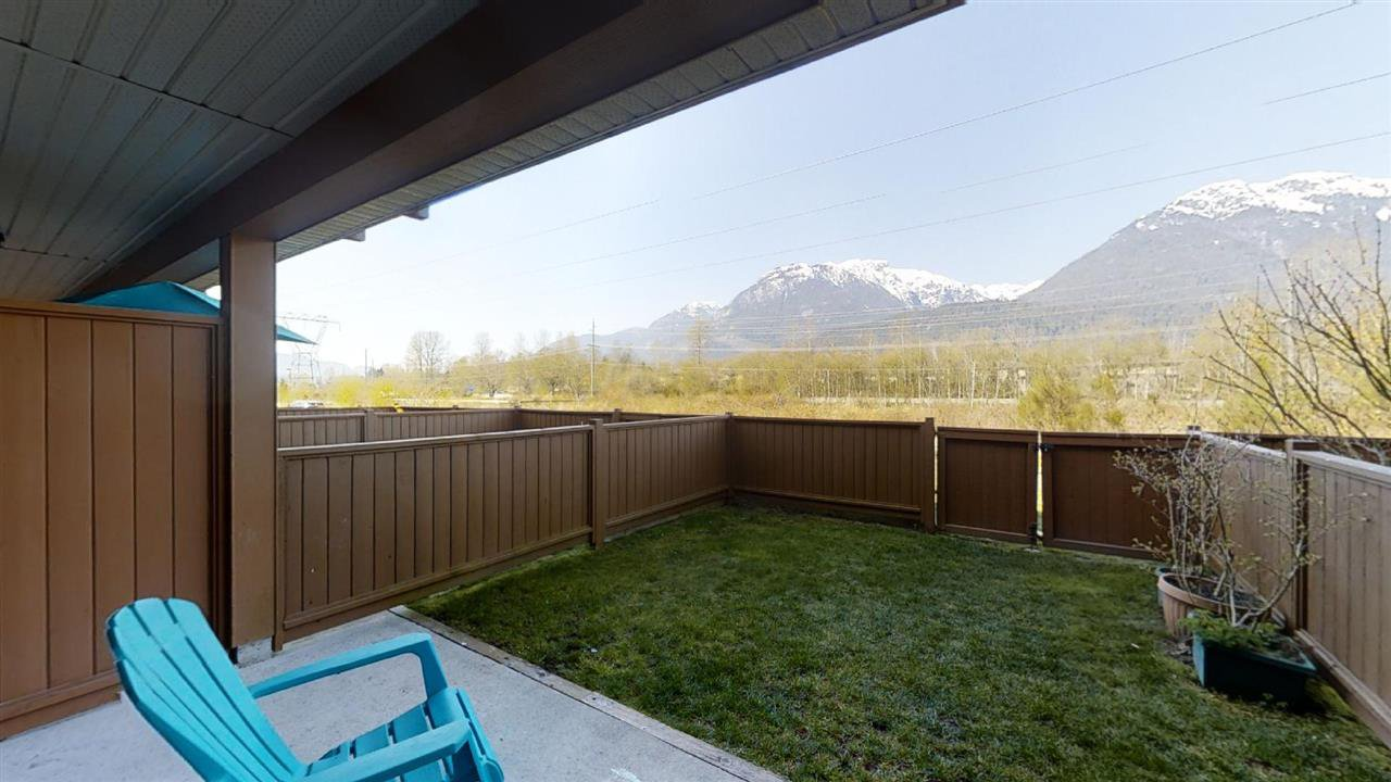 A townhome with a view! Patio and fenced yard as well as BBQ deck off the kitchen
