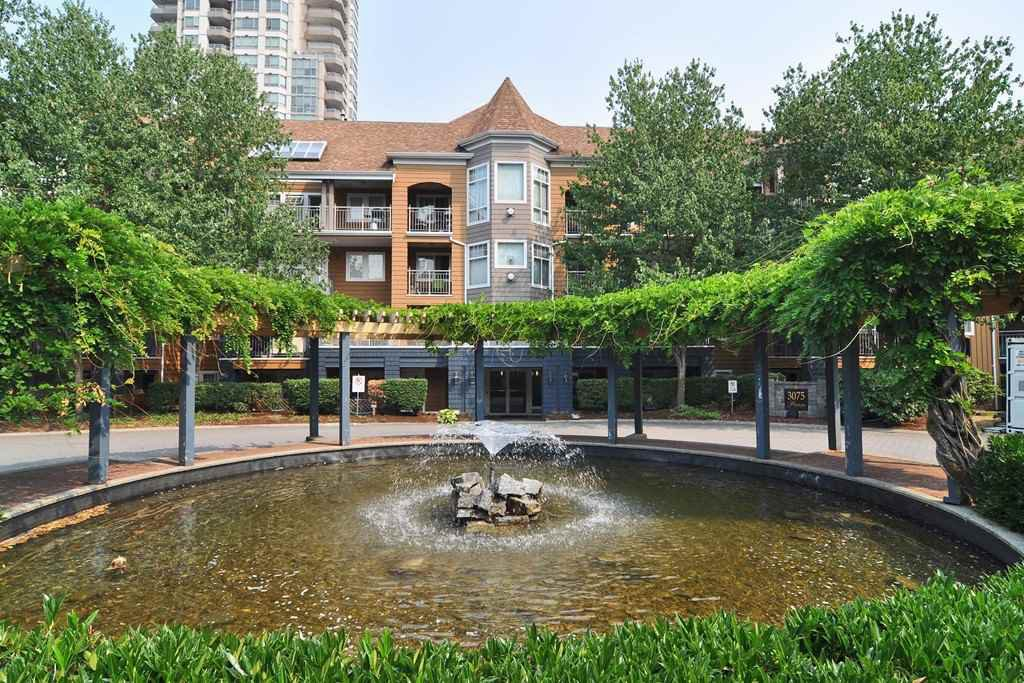 "Main Photo: 203 3075 PRIMROSE Lane in Coquitlam: North Coquitlam Condo for sale in ""Lakeside Terrace"" : MLS®# R2471149"