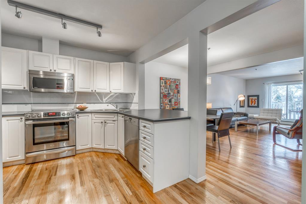 Immaculate and modern... real hardwood floors, open concept design!