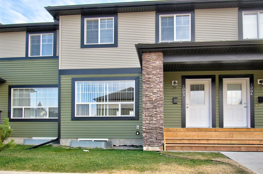 Main Photo: 1003 140 Sagewood Boulevard SW: Airdrie Row/Townhouse for sale : MLS®# A1040152