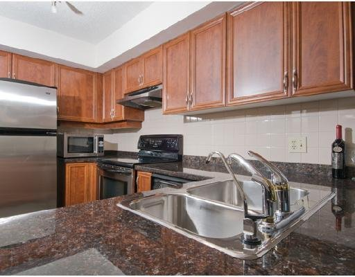 Kitchen: Completely renovated klitchen features thick granite counters, italian wood cabinets and stainless appliances