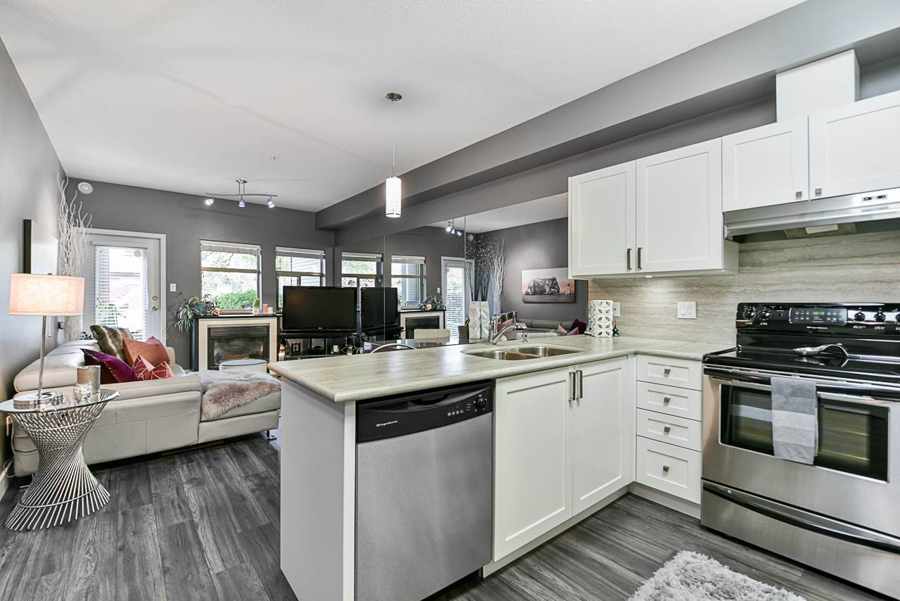 "Main Photo: 109 1591 BOOTH Avenue in Coquitlam: Maillardville Condo for sale in ""Le Laurentian"" : MLS®# R2413782"