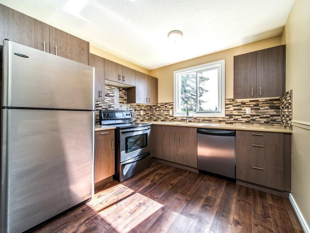 Beautiful new kitchen cabinets accented with QUARTZ counter tops , NEW Stainless STEEL Appliances.