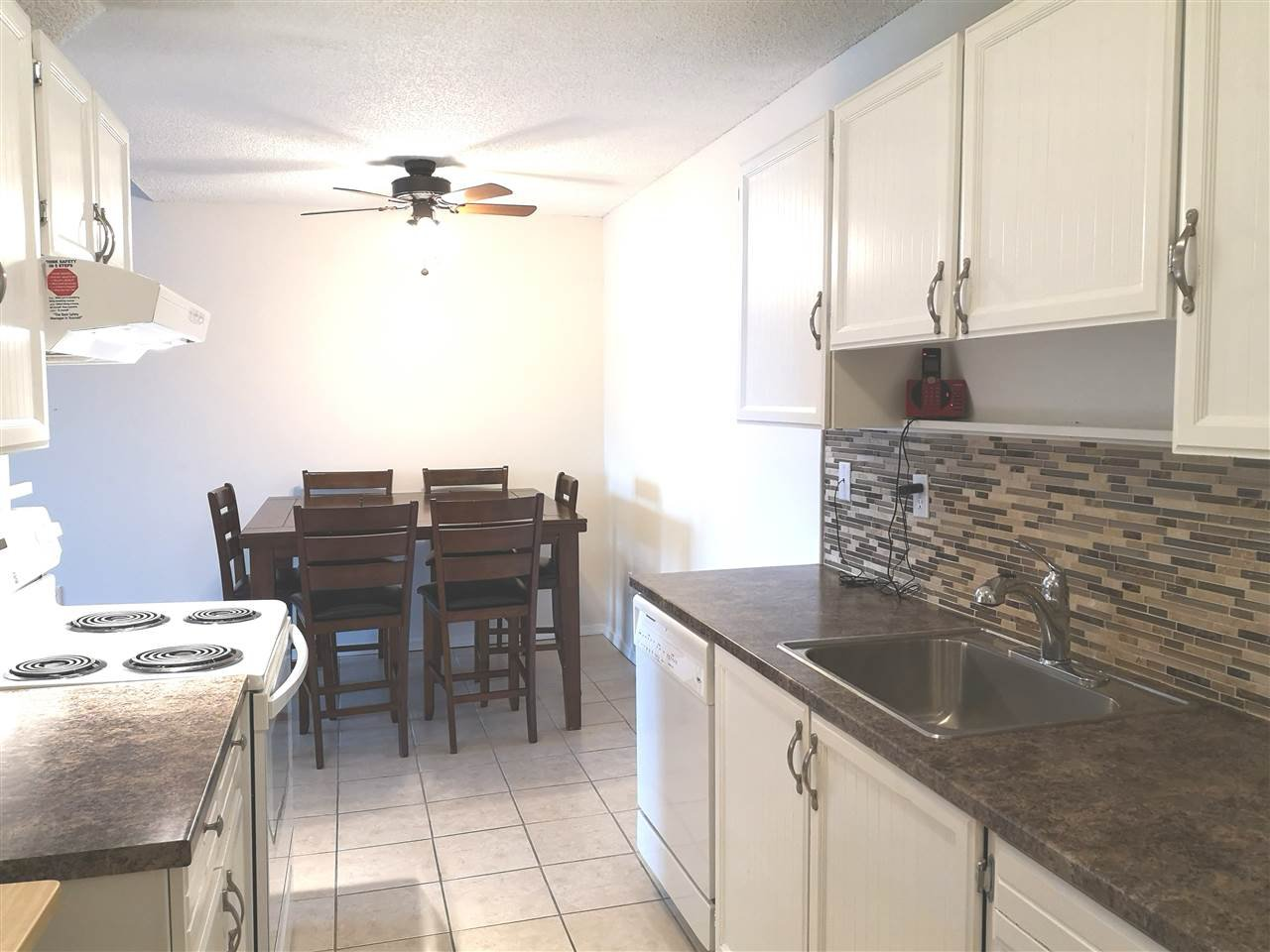 Updated cabinets, backsplash and counters
