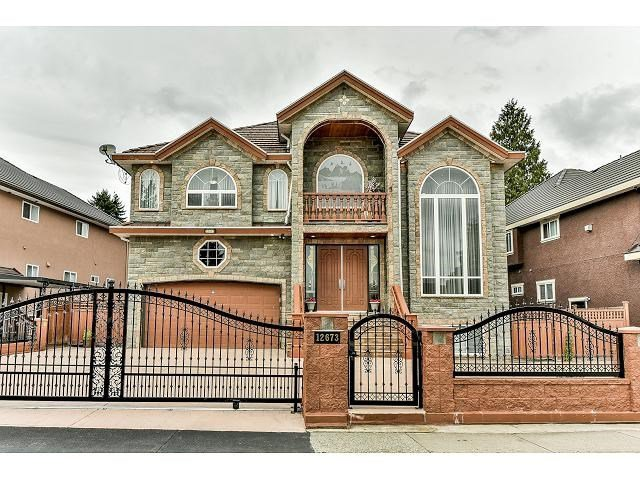 Main Photo: 12673 90A Avenue in Surrey: Queen Mary Park Surrey House for sale : MLS®# R2509205
