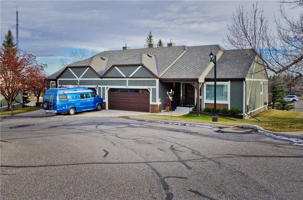 Main Photo: 84 COACH SIDE TC SW in Calgary: Coach Hill House for sale : MLS®# C4274521
