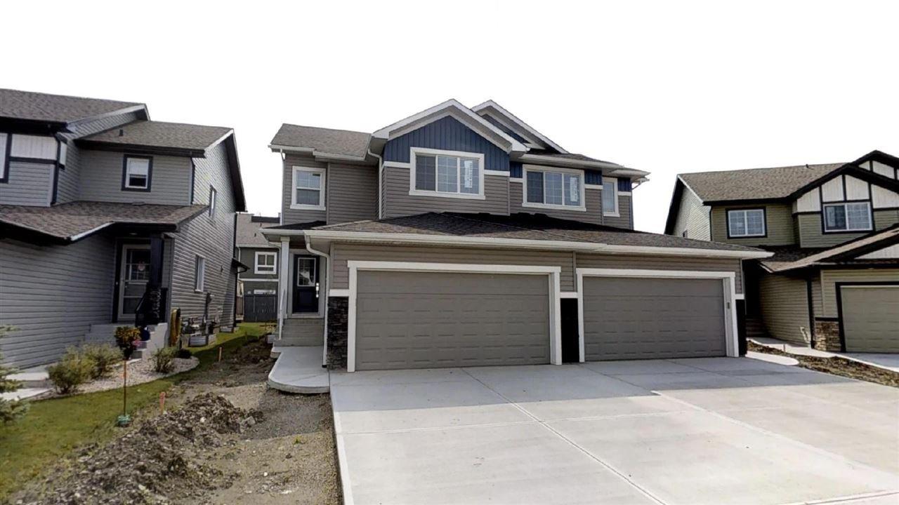 Main Photo: 7885 170A Avenue in Edmonton: Zone 28 House Half Duplex for sale : MLS®# E4169610