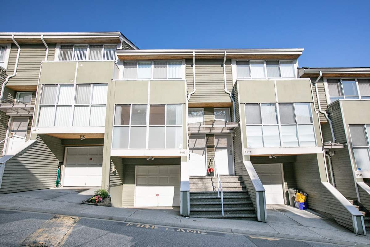 "Main Photo: 8412 KEYSTONE Street in Vancouver: Champlain Heights Townhouse for sale in ""MARINE WOODS"" (Vancouver East)  : MLS®# R2395420"