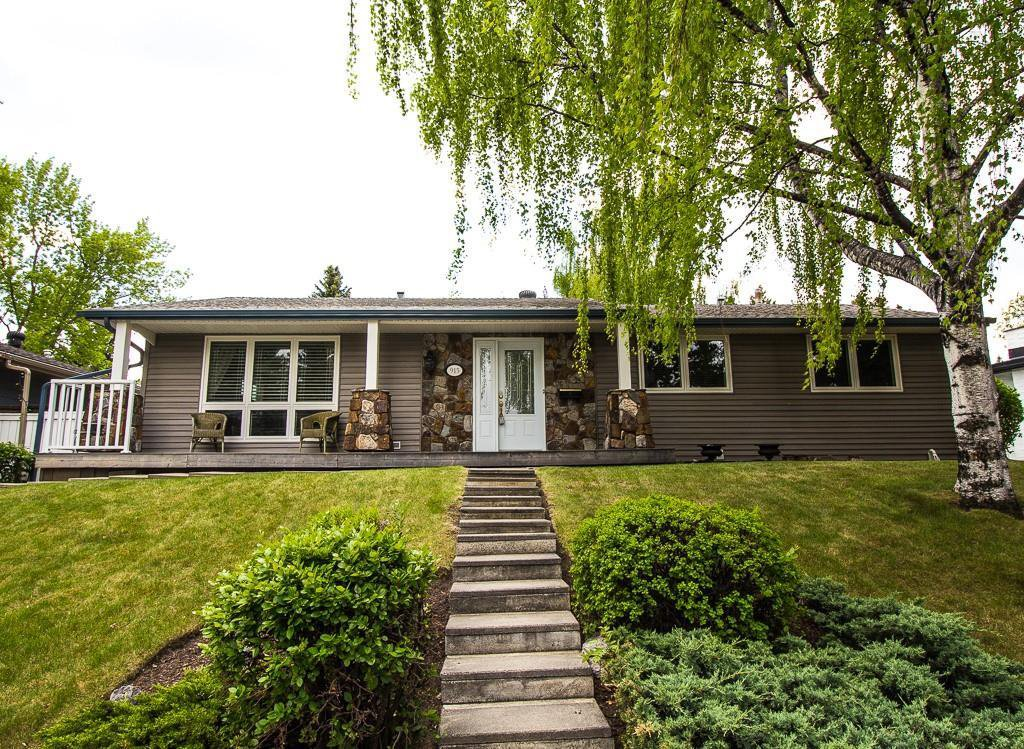 Main Photo: 915 Canna Crescent SW in Calgary: Canyon Meadows Detached for sale : MLS®# C4264269