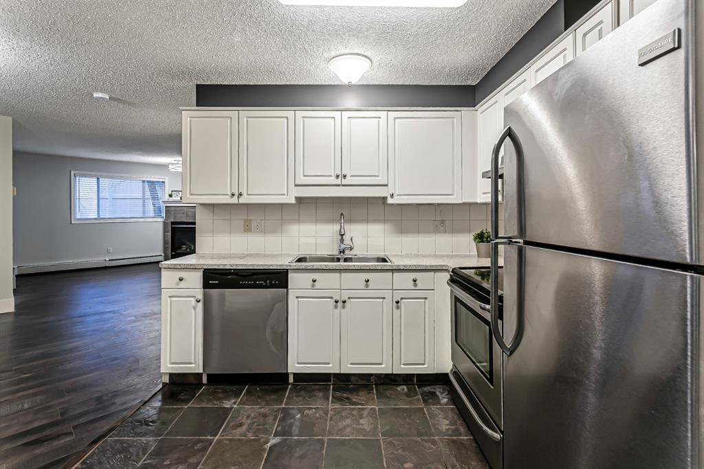 Photo 4: Photos: 116 10 SIERRA MORENA Mews SW in Calgary: Signal Hill Apartment for sale : MLS®# C4281143