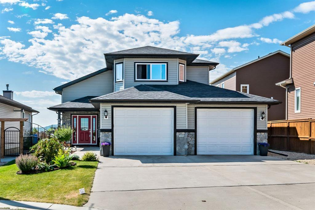 Main Photo: 605 Sunrise Close: Turner Valley Detached for sale : MLS®# A1019996