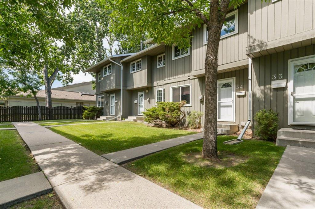 Main Photo: 34 6503 RANCHVIEW Drive NW in Calgary: Ranchlands Row/Townhouse for sale : MLS®# A1018661