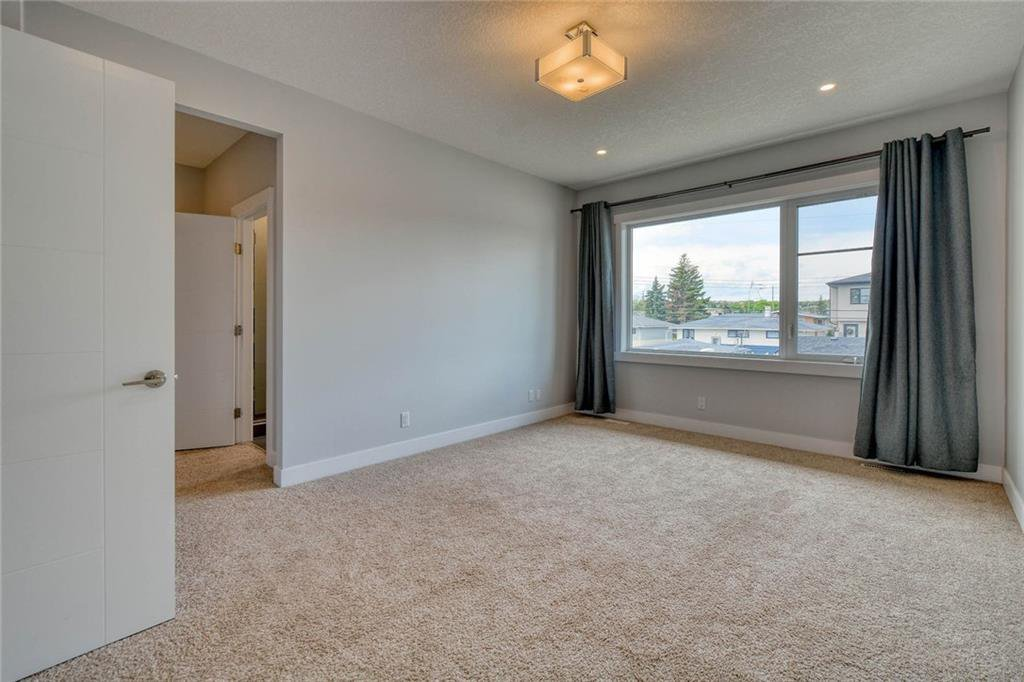 Photo 21: Photos: 911 42 Street SW in Calgary: Rosscarrock Semi Detached for sale : MLS®# C4305671