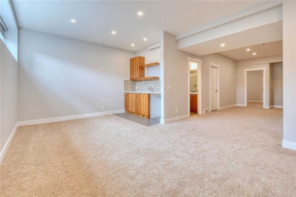 Photo 38: Photos: 911 42 Street SW in Calgary: Rosscarrock Semi Detached for sale : MLS®# C4305671