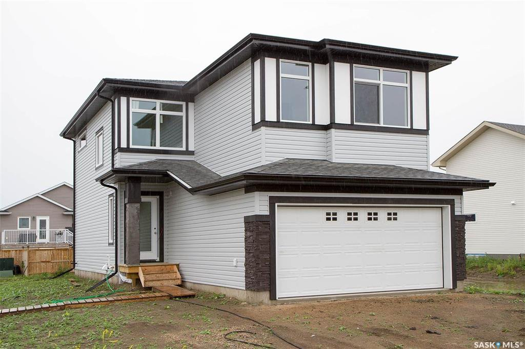 Main Photo: 414 Hassard Close in Saskatoon: Kensington Residential for sale : MLS®# SK779839