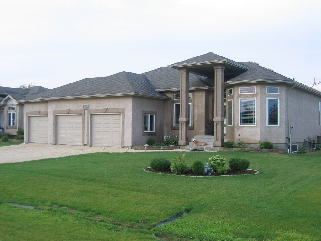 Exceptional quality & workmanship is evident in this custom Foster Built 1650 sf Bedroom Bungalow with 24x37 AT3 garage on a beautifully landscaped & fenced 88x150 lot in Oakbank