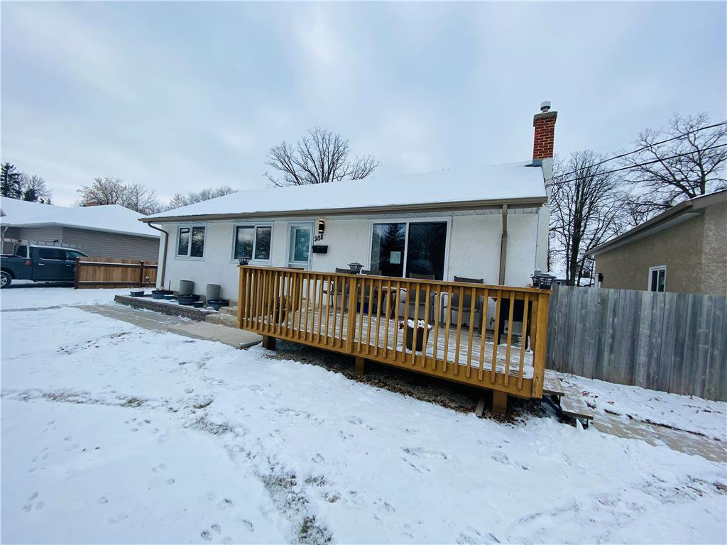 A home with great bones situated on Massive Charleswood lot!  Front patio is great in the warmer months for morning sunshine and coffee! East exposure brings in Natural light all morning!
