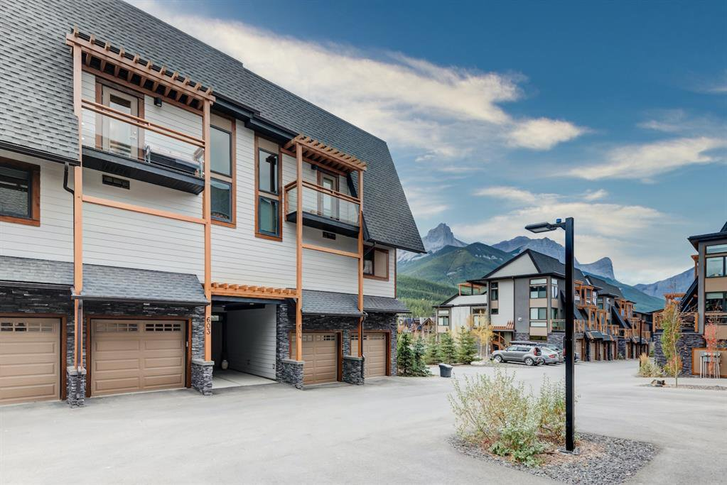 Main Photo: 603 102 Stewart Creek Rise: Canmore Row/Townhouse for sale : MLS®# A1041659