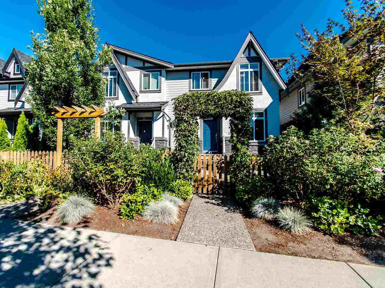 Main Photo: 21003 80 Avenue in Langley: Willoughby Heights Condo for sale : MLS®# R2496824