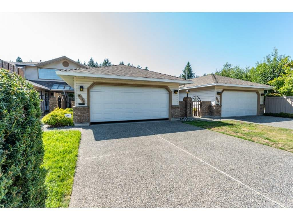 """Main Photo: 9769 148A Street in Surrey: Guildford Townhouse for sale in """"Chelsea Gate"""" (North Surrey)  : MLS®# R2394189"""