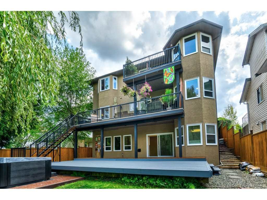 STUNNING curb-appeal with large decks on every floor. Over $250,000 in upgrades including new decks, railings, fencing, laundry, flooring, new gourmet kichen, hot tub, paint, windows, carpeting and much more.