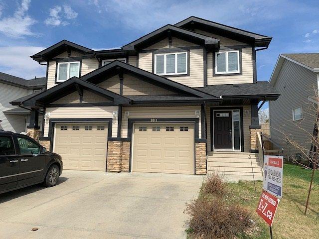 Main Photo: 9911 217 Street in Edmonton: Zone 58 House Half Duplex for sale : MLS®# E4186501