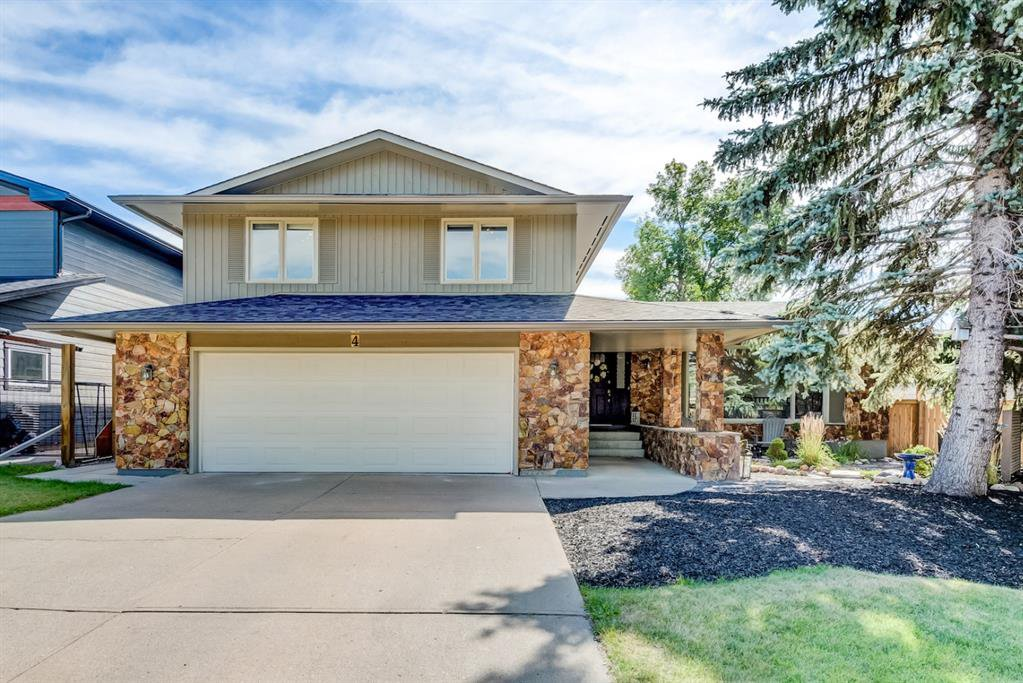 Photo 1: Photos: 4 LAKE PLACID Rise SE in Calgary: Lake Bonavista Detached for sale : MLS®# A1029014