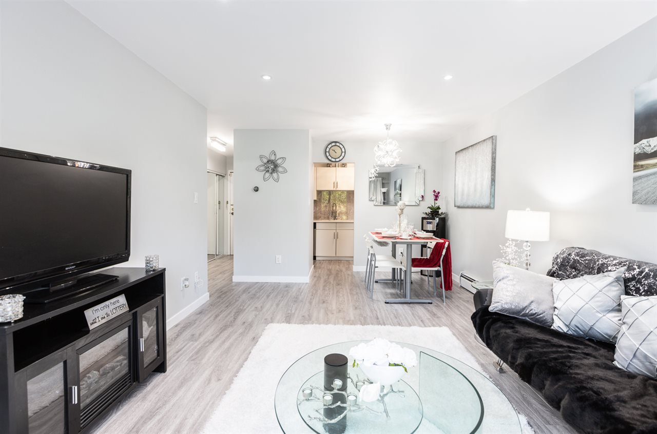 """Main Photo: 105 601 NORTH Road in Coquitlam: Coquitlam West Condo for sale in """"The Wolverton"""" : MLS®# R2474831"""