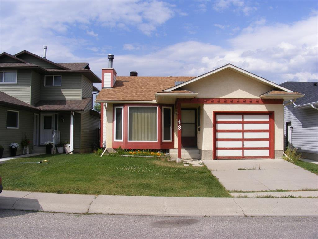 Main Photo: 48 CEDARGROVE Road SW in Calgary: Cedarbrae Detached for sale : MLS®# A1021175
