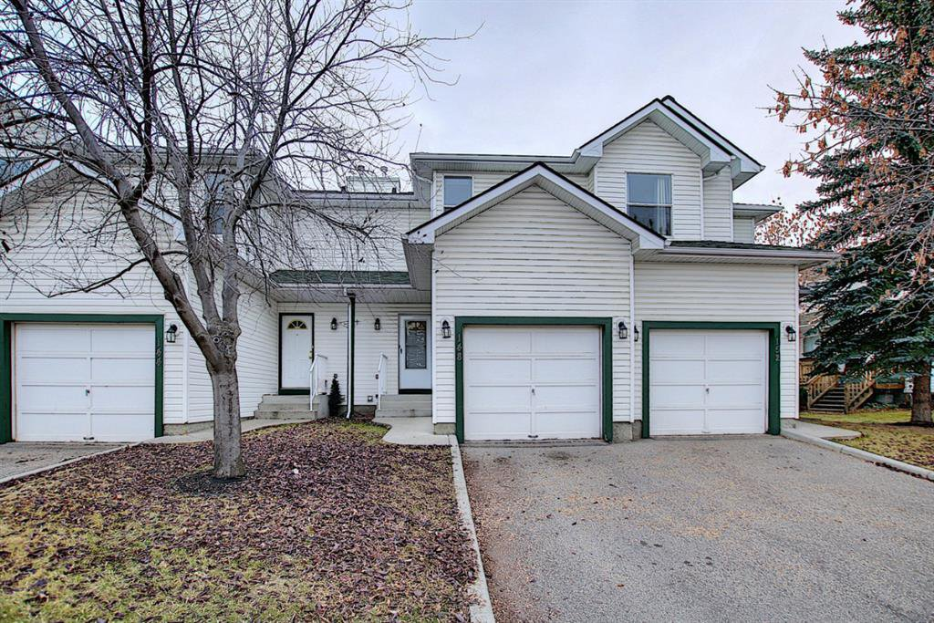 Main Photo: 148 Sandpiper Lane NW in Calgary: Sandstone Valley Row/Townhouse for sale : MLS®# A1047605