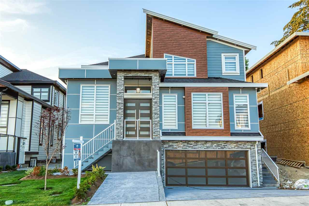 Main Photo: 15521 78 Avenue in Surrey: Fleetwood Tynehead House for sale : MLS®# R2475478
