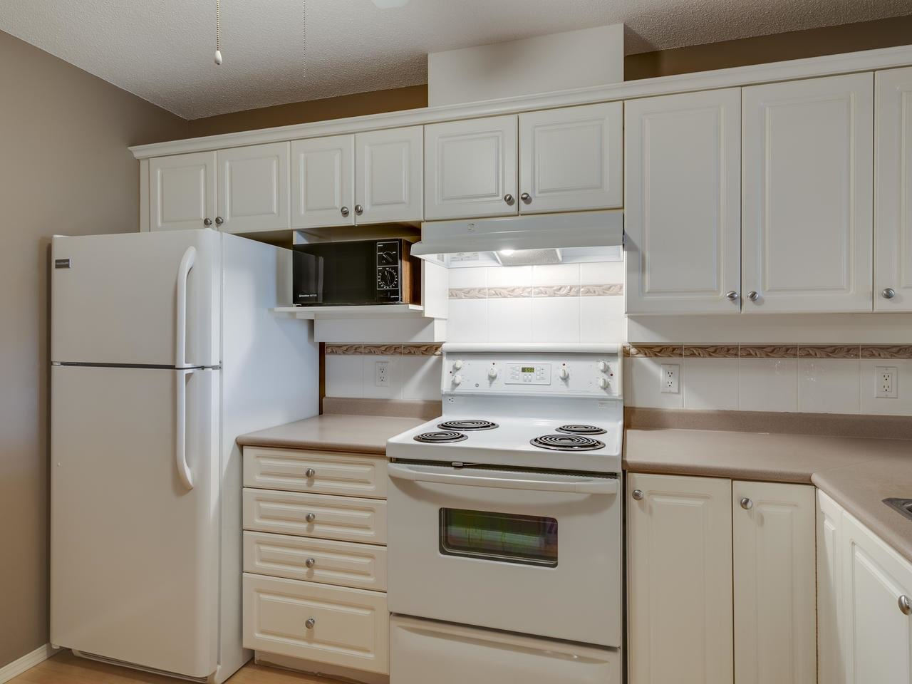 """Photo 7: Photos: 404 12148 224 Street in Maple Ridge: East Central Condo for sale in """"Panorama"""" : MLS®# R2461995"""