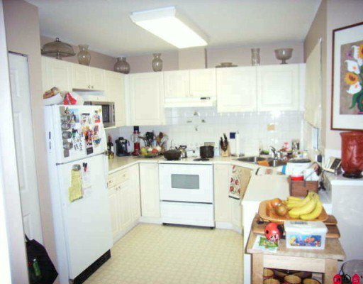 """Photo 4: Photos: 410 13900 HYLAND Road in Surrey: East Newton Townhouse for sale in """"HYLAND GROVE"""" : MLS®# F2927615"""