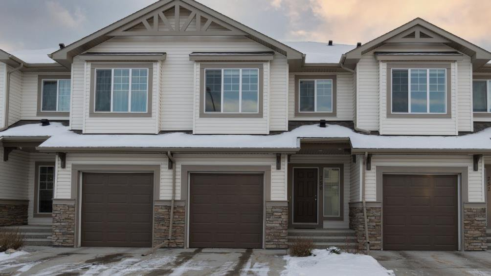 Main Photo: 250 Sunset Point: Cochrane Row/Townhouse for sale : MLS®# A1050873