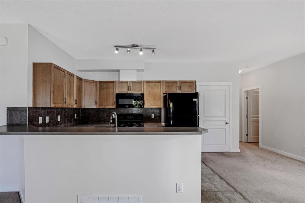 Photo 9: Photos: 1501 281 Cougar Ridge Drive SW in Calgary: Cougar Ridge Row/Townhouse for sale : MLS®# A1040162