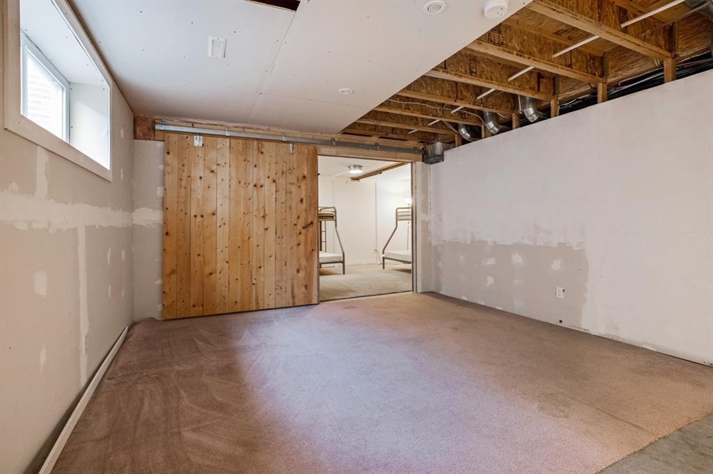 Photo 22: Photos: 1501 281 Cougar Ridge Drive SW in Calgary: Cougar Ridge Row/Townhouse for sale : MLS®# A1040162